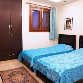 Hostelek és Ifjúsági Szállások - Woodpecker Apartments & Suites Pvt. Ltd. (Green Park)